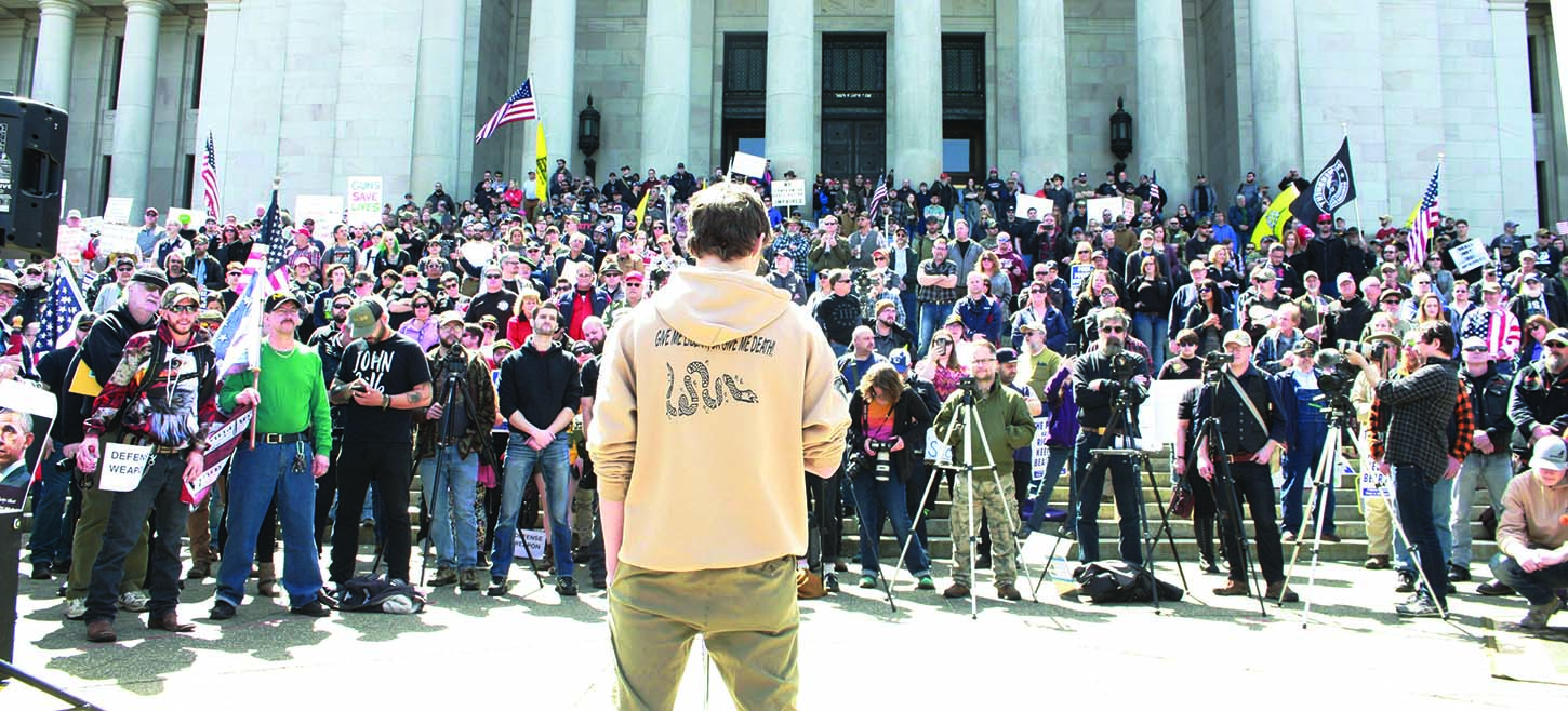 Pro-rights teen Aryeh Rohde (back to camera) spoke to a crowd of about 2,500 Second Amendment activists in Olympia during an April 18 rally protesting a new state gun control citizen initiative. (Dave Workman photo)