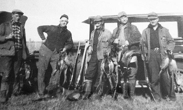 """Vintage images of long-past pheasant hunts are being used to raise the interest of today's wingshooters as can be seen by this image from a 1925 hunt on the Koester Farm. They dressed a lot different back in the """"old days,"""" but they seemed to shoot pretty good, too!"""