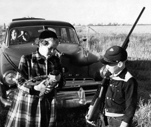 Even the youngsters have managed to get in on ringneck pursuits in South Dakota in years past. The kids in this image—Adrian holding pheasant and Von Versteg with shotgun—are probably retired by now.