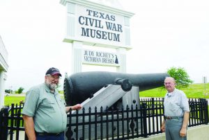 Author, left, and his oldest brother Elmer, right, standing with a 10-inch smooth bore confederate coastal gun with a range of 2.8 miles in front of the Texas Civil War Museum.