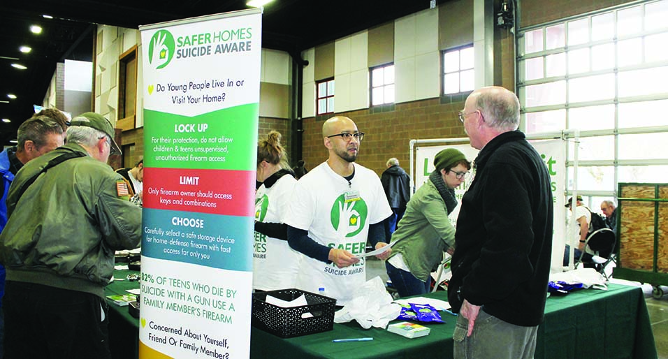 Volunteers for the Safer Homes suicide prevention program in the Northwest spoke with gun owners at the Washington Arms Collectors gun show last fall. (Dave Workman)