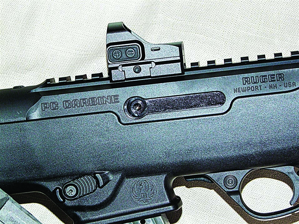You can see in the bolt where you install the charging handle, the magazine release and the intensity buttons on Truglo's TruTec Micro Subcompact Sight.
