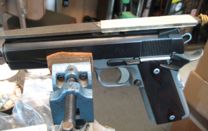 The author's modified file for lowering front sights. The plastic creates a safe area that glides over the top of the rear sight keeping the cut on the front sight square with the top of the rear.